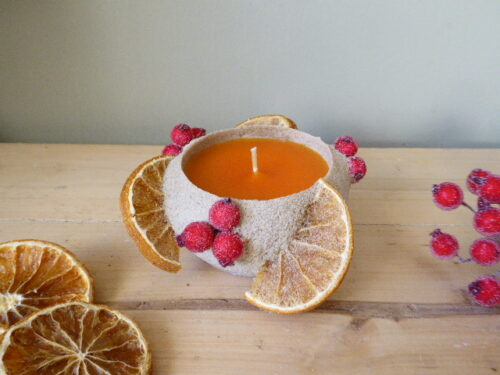 Orange and red berry sand candle
